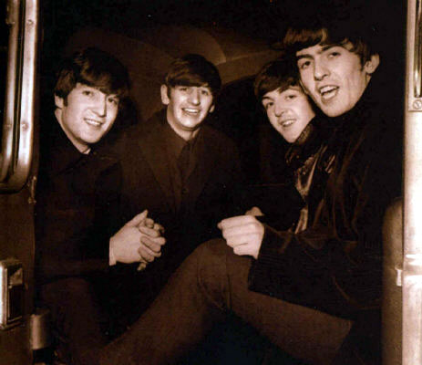 The Beatles in a train